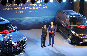 SAIC Maxus presents SCO Secretariat with two luxury cars during ceremony at SCO Headquarters