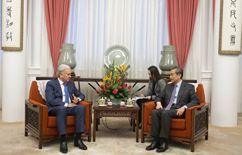 SCO Secretary-General Rashid Alimov meets with State Councillor and Foreign Minister of China Wang Yi