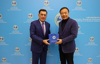 SCO Secretary-General meets with World Tourism Alliance Secretary-General Liu Shijun